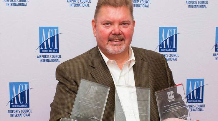 Randy Goodman, director, concessions, Houston Airport Systems with three of the awards