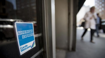 American Express Reports Revenue Drop