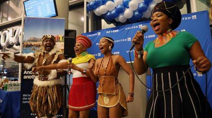 Traditional South African Dancers perform at the gate celebration at Newark Liberty International Airport