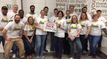 Enterprise staff help pack and distribute food at the food banks