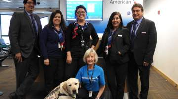 Smokey with American Airlines customer service team members at El Paso Airport