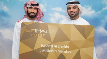 From left, Shehhi is congratulated by Yasser Al Yousuf, managing director, Etihad Guest