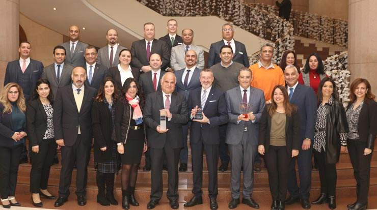 IHG Cairo Citystars team holding the three awards