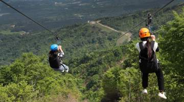 Visitors enjoying the high-speed zip tour operated by Lotte Arai Resort